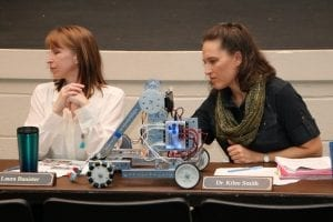 Laura Banister and Dr. Kilee Smith get 'schooled' on robotics.