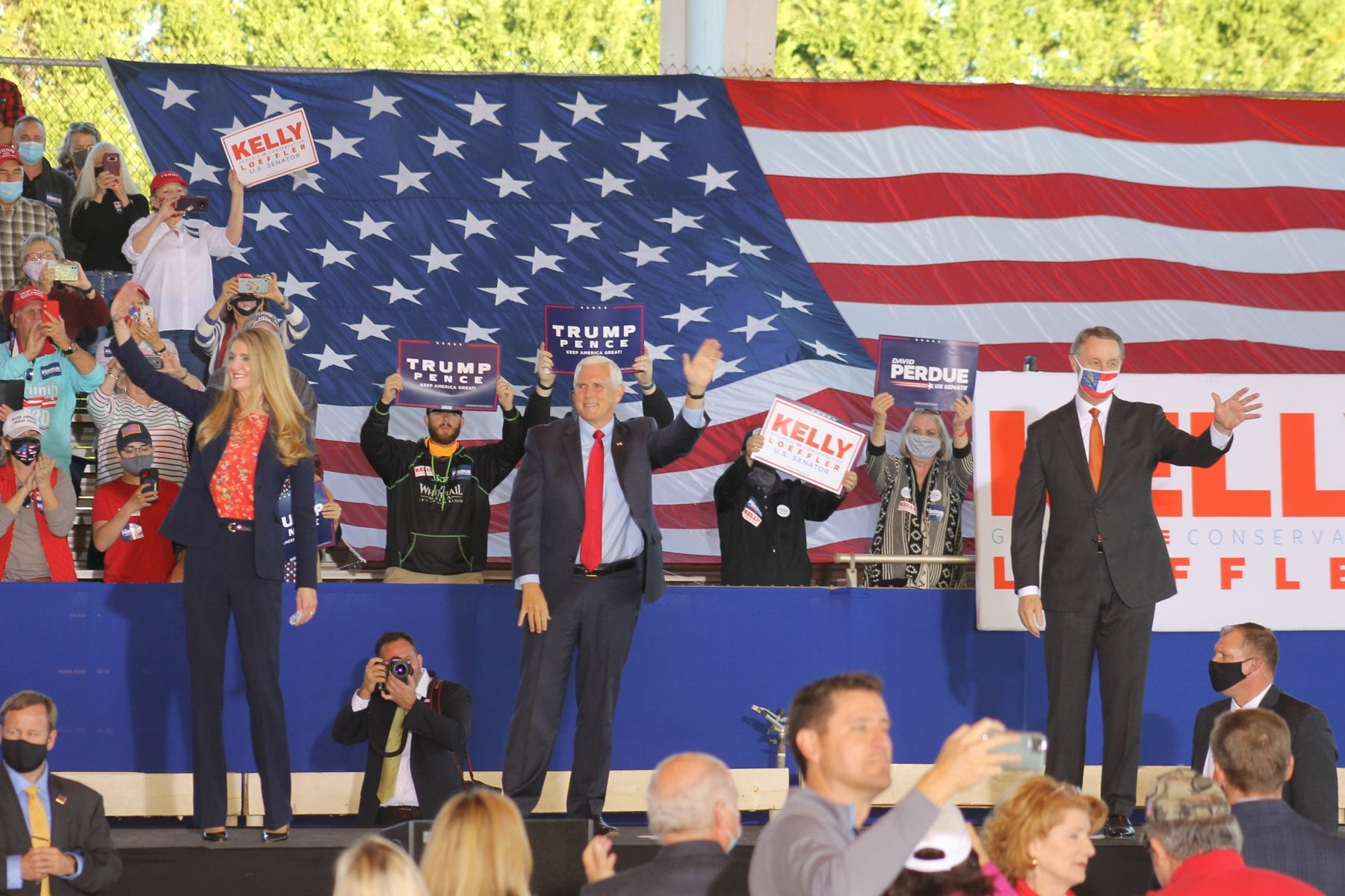(left to right) Kelly Loeffler, Mike Pence and David Perdue engage with Georgia crowd at rally